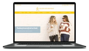Yellow Kiss Clothing Boutique website shown on computer